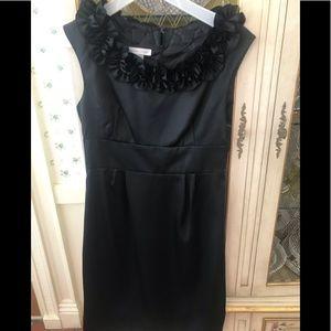 New black satinesque sheath dress .